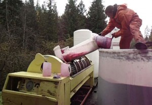 We do most of the work by hand, including bucketing wine into the press.